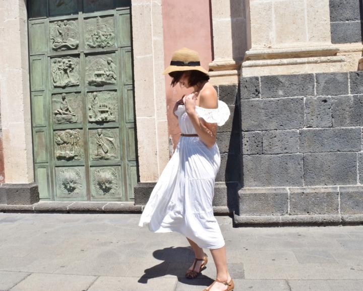 The long white skirt as a white ruffledress.